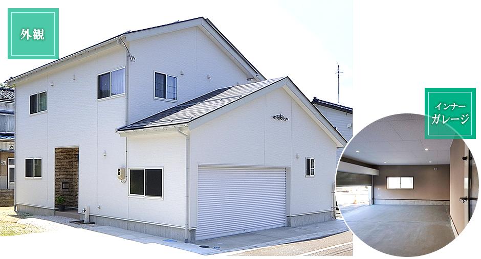 外観はオシャレでスタイリッシュな白い外壁の家に広々としたインナーガレージ